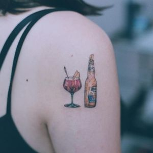 Corona and cocktail tattoo by Baam Kr #Baam #Baamkr #drinktattoos #color #realism #realistic #hyperrealism #fineline #minimal #detailed #corona #cocktail #peaches #glass #bottle #lime #alcohol