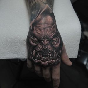 Evil orc hand tattoo by Edgar Ivanov. #blackandgrey #realism #handtattoo #orc #EdgarIvanov