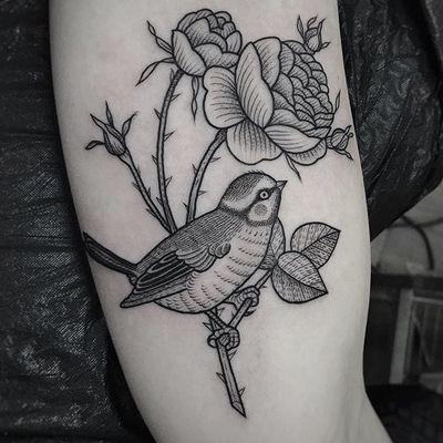 Nice piece by Suflanda #Suflanda #flower #bird #scrimshaw #blackwork #tattoooftheday