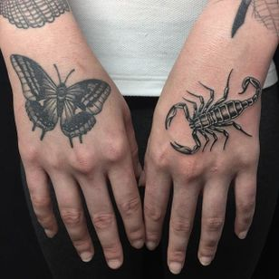 Black and grey hand tattoos by Javier Betancourt. (IG - javierbetancourt) #SESSIONS #JavierBetancourt #HandTattoo #Scorpion #Butterfly