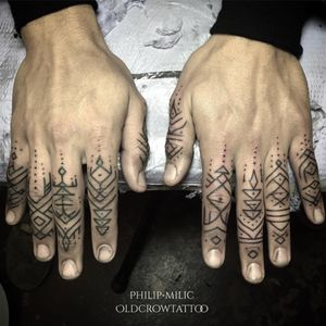 A bunch of celestial glyphs along a clients fingers by Philip Milic (IG—pmtattoos). #blackwork #fingers #glyphs #microtattoo #minimalism #ornamental