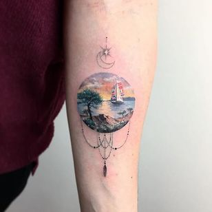 Ornate and tender, a sailboat sails in the sunset, by Eva Galipdede. (via IG—evakrbdk) #microtattoo #microscenery #circlescene #tinytattoo