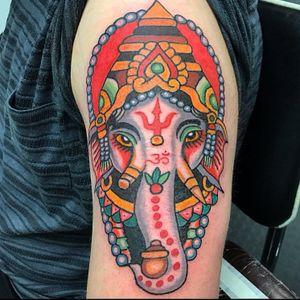 Tattoo by Robert Ryan #RobertRyan #color #traditional #Hindu #surreal #Ganesha #om #symbolism #trident #lotus #crown #pearls #tusks #elephant