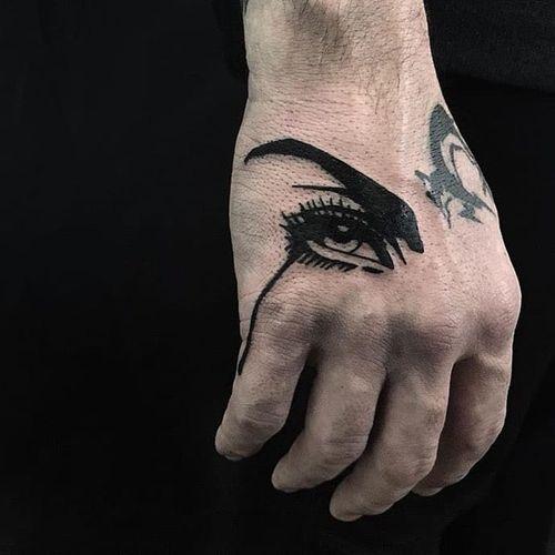 Crying eye tattoo by Stray Dog Society #StrayDogSociety #blackworktattoos #blackwork #eye #crying #sadgirl #graphic #popart #eyelashes #bold