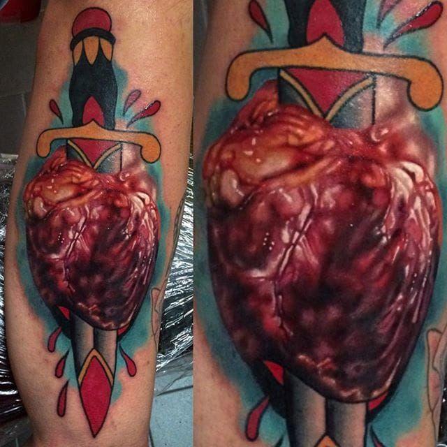 Mash-up anatomical heart tattoo by Yogi Barrett. #YogiBarrett #mashup #anatomicalheart #colorrealism #hyperrealism #dagger