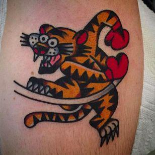 Solid swingin' tiger tattoo done by Mark Cross. #MarkCross #rosetattooNYC #TraditionalTattoo #BoldTattoos #tiger #boxer