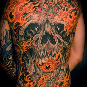 Skull and fire by Mike Rubendall #MikeRubendall #color #blackandgrey #Japanese #backpiece #skull #fire #cherryblossoms #petals #death #bones #dragon #flowers #tattoooftheday