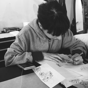 Ligia at work (photo by Alex Wikoff) #gristletattoo #nyc #shop #blackwork #illustrative #woodcut #fineline