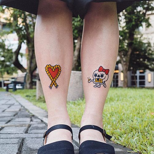 Skull and heart by Woo Loves You #Woolovesyou #WoohyunHeo #newtraditional #redink #skull #bow #teeth #goldtooth #heart #rope #love #valentine #tattoooftheday