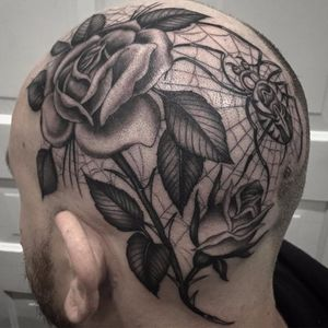 Caught in the web by Chris Stuart #ChrisStuart #blackandgrey #oldschool #traditional #spiderweb #spider #rose #rosebud #leaves #nature #tattoooftheday