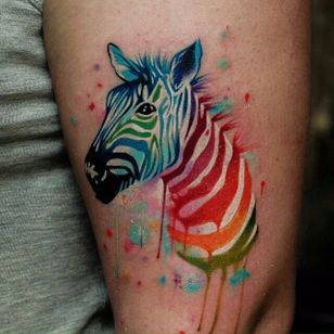 Rainbow watercolor zebra tattoo by Den Kor. #inksplatter #watercolor #rainbow #colorful #zebra #DenKor