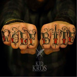 Wolf Bite Knuckle Tattoos by Kid Kros #KidKros #Knuckles #KnuckleTattoos #HandTattoos #Traditional #Black #Lettering #Script