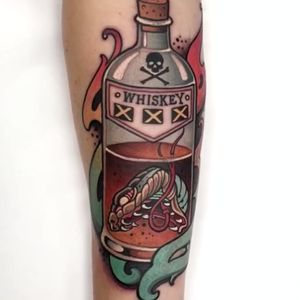 Snake head whiskey tattoo by W.T. Norbert #wtnortbert #drinktattoos #color #neotraditional #snake #snakehead #whiskey #bottle #glass #skull #crossbones #fire #drunk #drink #alcohol