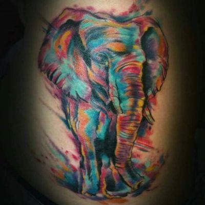 A super vibrant watercolor elephant by Gotti Briganti (IG—tattoosbygotti). #elephant #GottiBriganti #watercolor