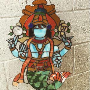 A depiction of Matsya cast in stained glass via Gina Ferrara (IG—oxbowglass). #fineart #GinaFerrara #oxbowglass #Matsya #stainedglass