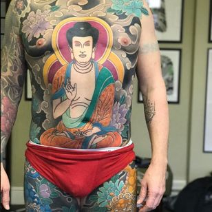 A serene bodysuit featuring the Buddha and flora by Luca Ortis (IG—lucaortis). #Buddha #Irezumi #Japanese #largescale #LucaOrtis #traditional