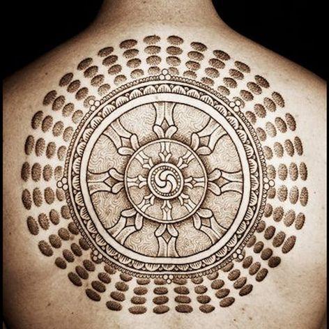 An amazing Wheel of the Dharma by Jondix (IG—jondix). #blackwork #Dharmachakra #DharmaWheel #Jondix #WheeloftheDharma