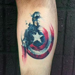 Brushstroke watercolor Captain America tattoo by Georgia Grey. #illustrative #sketchy #watercolor #GeorgiaGrey #brushstroke #CaptainAmerica