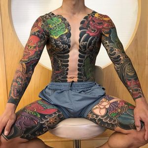 Full bodysuit in the works by State of Grace's owner Ryudaibori #stateofgracetaki #Ryudaibori #Horitaka #Japanese #masks #nohmasks #dragon #demon #oni #clouds #color #warrior #lady #DharmaWheel #waves #tattoooftheday