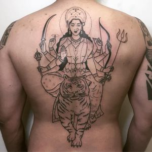 Durga and tiger tattoo by Tati Compton #TatiCompton #handpoketattoos #blackwork #linework #dotwork #Durga #Hindu #tiger #goddess #deity #junglecat #trident #sword #bowandarrow #shell #lotus #mudra #cat #pattern #nonelectric #stickandpoke