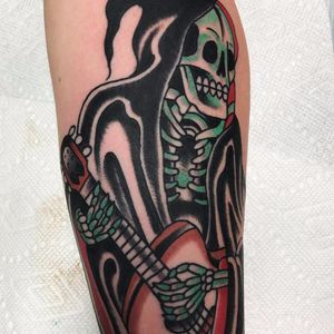 Guitar Playin Reaper tattoo by Mike Fite #MikeFite #color #traditional #reaper #grimreaper #death #skull #bones #skeleton #guitar #musictattoo #tattoooftheday