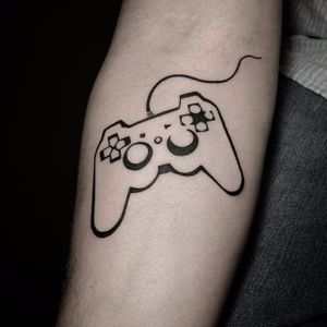 PlayStation-inspired tattoo by Mocambo Tattoo. #minimalist #playstation #sony #nostalgia #videogames #retro #childhood #controller