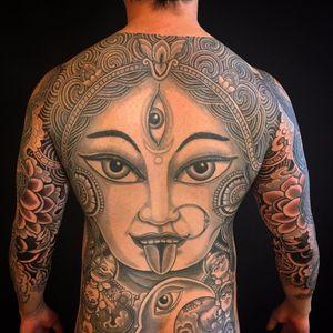 Kali back piece by Yoni Zilber #yonizilber #blackandgrey #blackwork #goddesskali #thirdeye #pattern #jewelry #portrait #skulls #moon #clouds #lotus #flowers #waves #Hindu #tibetanskull #tattoooftheday