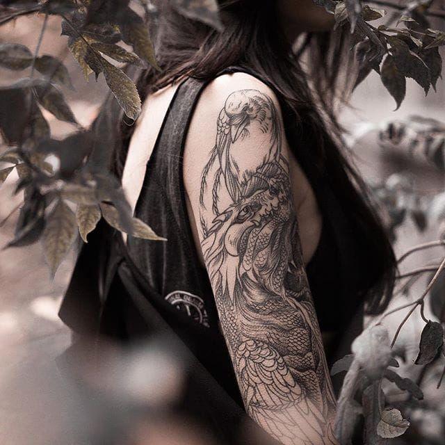 The girl with the dragon tattoo. Pictured, Lesya Kovalchuk. Dragon tattoo by Sasha Mashiuk. (Photo by Dmitriy Mel.) #LesyaKovalchuk #blackwork #mythology #dragon #SashaMashiuk