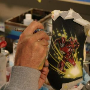 Dank Horkey painting The Flash on a prothesis. #amputees #DanHorkey #ProstheticInk #tattooedprostheses #TheFlash #veterans