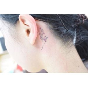 Floral behind-the-ear tattoo by Banul. #Banul #TattooistBanul #flower #floral #microtattoo #fineline #subtle #micro #tiny #feminine #girly #behindtheear #trend #southkorean