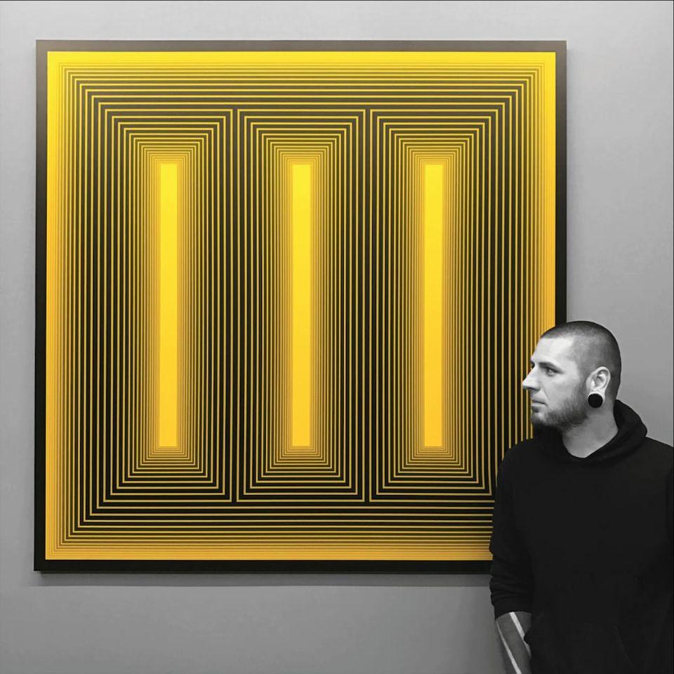 Ben Volt standing in from of some modern art that reminiscent of his own (IG—benvolt). #abstract #avantgarde #BenVolt #bold #blackwork #experimental #geometric #minimalist #ornamental