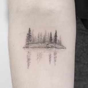 Minimal landscape tattoo by Lindsay April #LindsayApril #lindsayapriltattoo #landscapetattoo #fineline #minimal #blackandgrey #small #landscape #reflection #trees #forest #sea #lake #nature