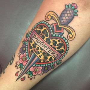 Girly traditional dagger tattoo by Sarah K. #SarahK #girly #traditional #dagger #flower #heart #heartdagger