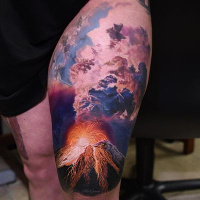 Volcano tattoo by Phil Garcia #PhilGarcia #besttattoos #color #realism #realistic #hyperrealism #clouds #smoke #volcano #nature #lava #sparks #light #landscape #tattoooftheday