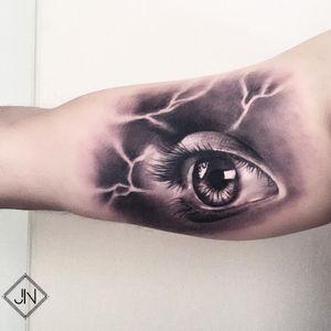 Lightning eye tattoo by Jefree Naderali #jefreenaderali #eyetattoos #blackandgrey #realism #realistic #hyperrealism #reflection #eye #eyelashes #lightning