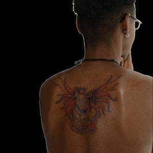 "Tracy Cooper Harris' phoenix tattoo, ""Still I Rise"" #warink #exhibition #war #veteran #veterans #army #usarmy #soldier #MayaAngelou #backtattoo #phoenix #flames"