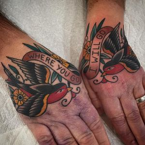 Hand tattoos by Chris Stuart #ChrisStuart #birdtattoos #color #traditional #handtattoo #bird #feather #wings #banner #text #quote #flowers #floral #swallow