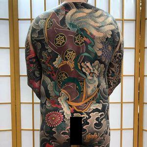 Kitsune bodysuit by Buslay #Buslay #Japanese #bodysuit #Kitsune #chrysanthemum #clouds #flowers #fire #kimono #fox #deity #demon #scroll #tattoooftheday