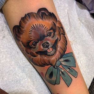 A friendly, smiling pomeranian tattoo by Jody Dawber. #dog #pomeranian #neotraditional #JodyDawber #cute