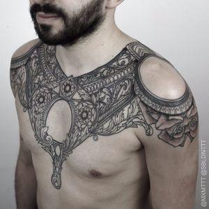 A highly ornamental black and grey chest-piece Maxime Buchi (IG—mxmttt). #elaborate #floral #geometric #illustrative #MaximeBuchi