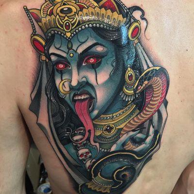 Goddess Kali portrait tattoo by Javier Franko #JavierFranko #portraittattoo #color #neotraditional #portrait #GoddessKali #Kali #deity #goddess #cobra #skulls #jewelry #pearls #gold