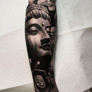 A statuesque black and grey depiction of Buddha by Nathan Herbert (IG—nathanhebert). #blackandgrey #Buddha #NathanHerbert
