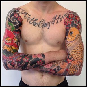 The battle of the sleeves: Dragon vs. Koi fish. By Rhys Gordon #RhysGordon #Japanese #traditionaljapanese #sleeve #Japanesesleeve #koifish #dragon #cherryblossom
