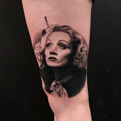 Marlene Dietrich tattoo by Rocky Burley #RockyBurley #ladytattoo #ladyhead #portrait #realism #realistic #hyperrealism #actress #marlenedietrich #smoking #cigarettes #jewel #bow #lady #famous #tattoooftheday