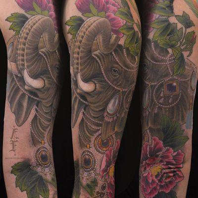 Elephant tattoo by Antony Flemming #AntonyFlemming #color #neotraditional #elephant #animal #flowers #peony #gems #jewelry #pearls #tusks #diamonds #leaves #nature #realistic #tattoooftheday