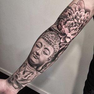 A depiction of Buddha between a lotus and a chrysanthemum via Lil B (IG—lilbtattoo). #blackandgrey #Buddha #chrysanthemum #LilB #lotus #realism #religious #RobinHernandez