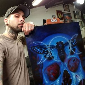Christian Perez posing next to one of his astound skull paintings (IG—christian1perez). #ChristianPerez #fineart #oilpaintings #skulls