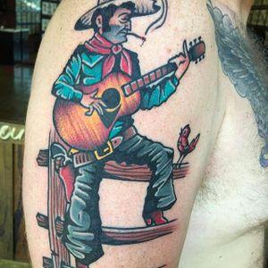 Cowboy playing guitar Tattoo by Pancho #PanchosPlacas #Oldschool #Traditional #Cowboytattoo #cowboy #guitar