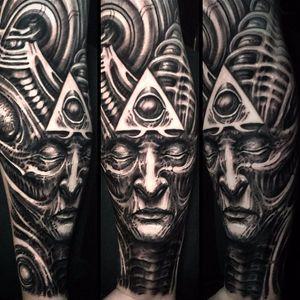 All seeing specter by Jeremiah Barba #jeremiahbarba #blackandgrey #biomechanical #Bioorganic #eyeofprovidence #pyramid #face #portrait #HRGiger #tattoooftheday