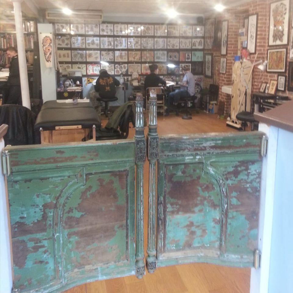 Greenpoint Tattoo Co.'s vintage saloon doors (IG—greenpointtattooco). #GreenpointTattooCo #NYCtattooshops